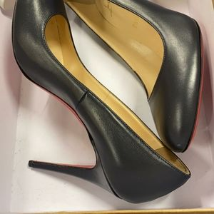 A deep Navy 3 inch pumps from Christian Louboutin
